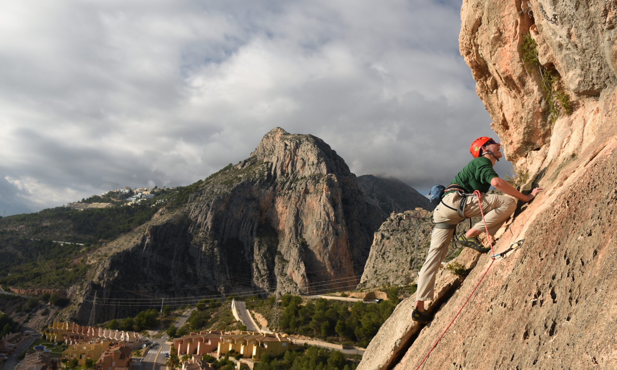 Cameron Hygate heading up to the chain on his first 6a Lobo at Sierra De Toix, Costa Blanca