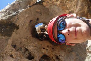The classic through hole of Pequeño saltamontes, 5a at Gandia, Northern Costa Blanca.
