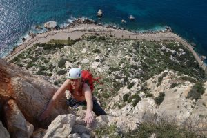 Simon Lake seconding pitch 4 of the epic climb Costa Blanca on the Penon D'Ifach.