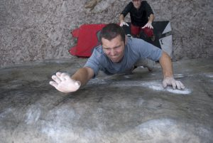 Naill focus on slapping the last hold, as he uses some force to overcome a font slab.