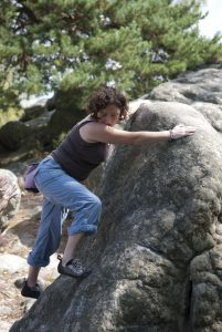 Elaine looks for the next foot hold on a font slab.