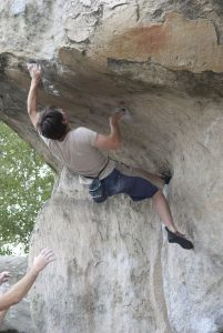 Sunnier Climbs head coach working on the amazing Bis Du Cul Du Chein a classic 7a problem through this impressive roof!
