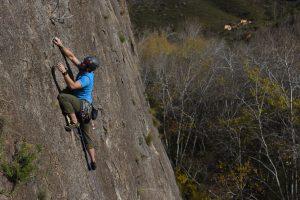 Slab climbing on Intrpedas 6a on the Macizo Del Ali in Chodes, near madrid.