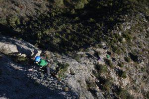 A climber makes there way up the exposed Escaper Primera, 5a, Macizo Del Ali, Chodes, Madrid.