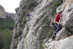 Climbers on Dime Dime in the background and Señor Nesbit Rides Again, in a nice warming up sector at Sella.