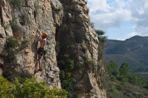 A climber enjoying the sun at the shelter Font D'Axia, Xalon Valley, Costa Blanca