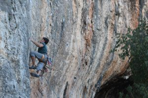 An unknown climber tackles Pure de Pascueros a classic 7b at Bellus in the north of Costa Blanca