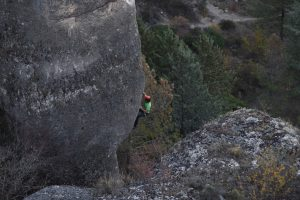 A climber on the amazing steep pocketed limestone of Cuenca.