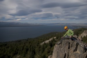 belaying on top of Cerro Otto, with stacked lenticular clouds in the background.