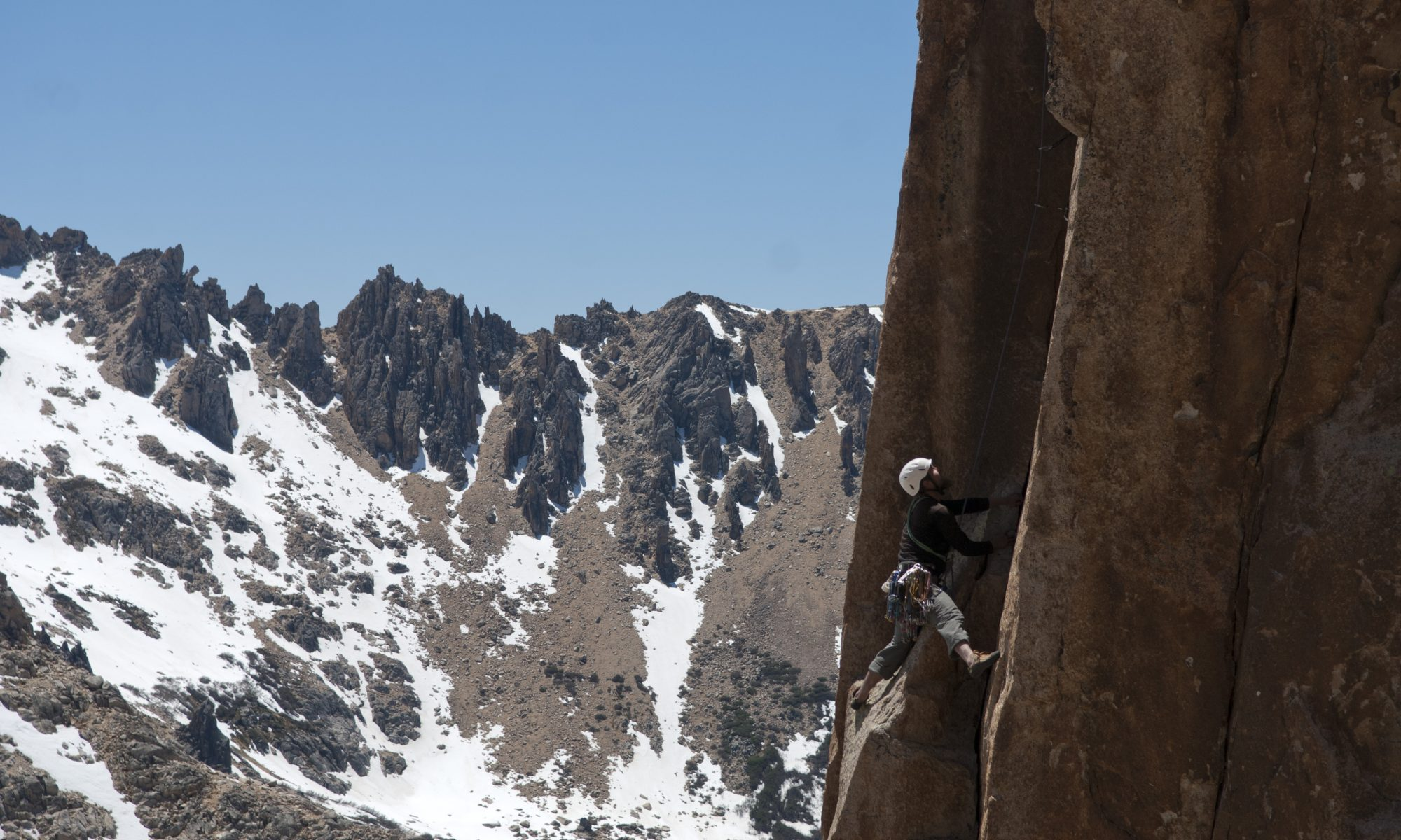 A climbing seconding the classic HVS corner pitch on the M2 tower ast Frey, Agentina.