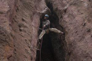 Bridging up a chimney/groove in Mmanquin near bariloche Frey.