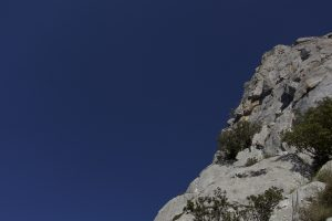 A rock coloured climber climbs up Espolon For on Cueto Agero.